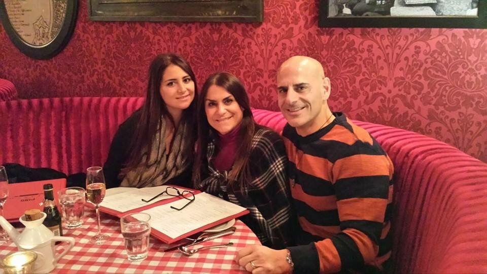 The author, Alaina Galiano, at dinner with her parents.